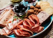 charcuterie plate with meats and black olives