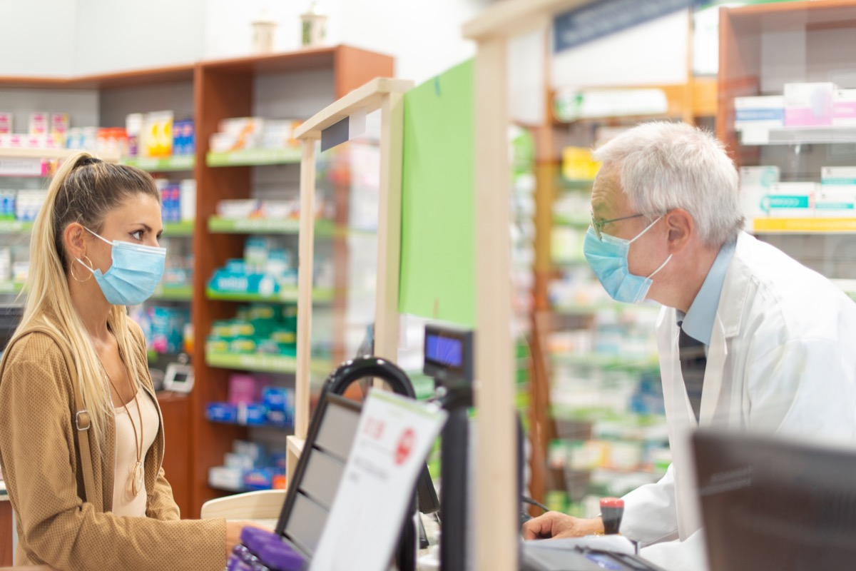 young blonde woman checking out at a pharmacy