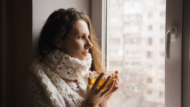 cold woman drinking a cup of tea