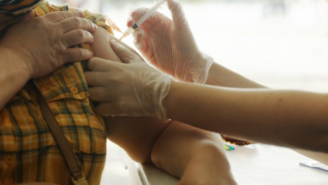 Close up of vaccine injection in arm