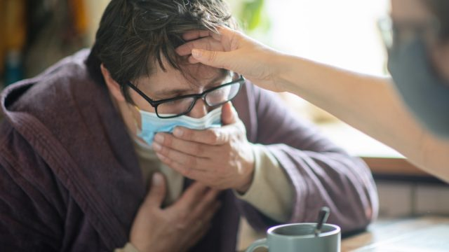 Man suffering from virus disease at home
