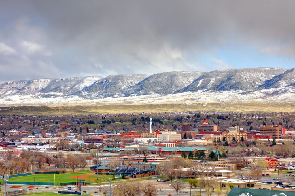 A view of Casper, Wyoming with snowy mountains in the background