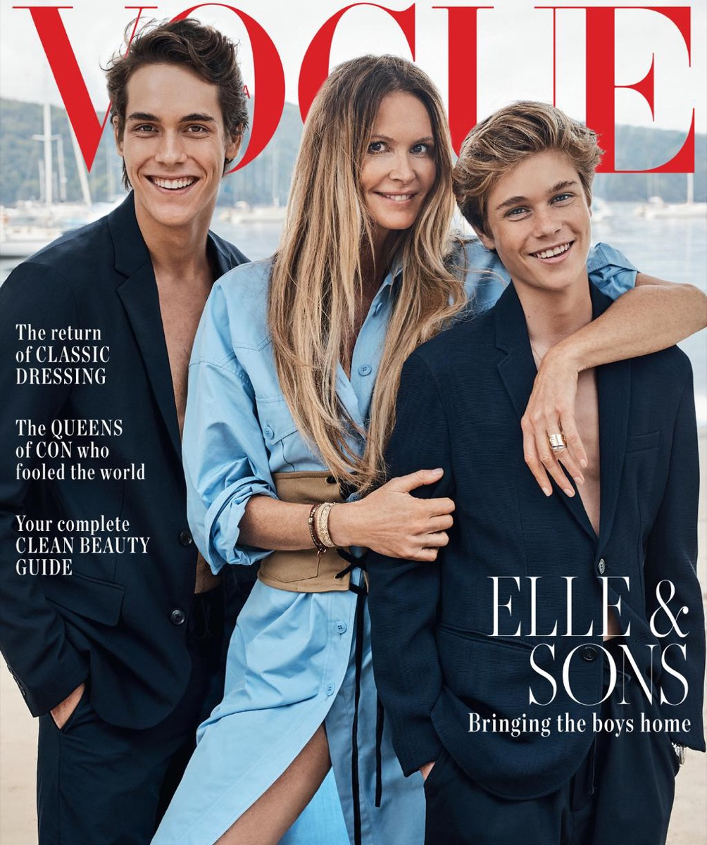 elle macpherson in a blue dress and her two sons in suits with no shirts on vogue australia cover