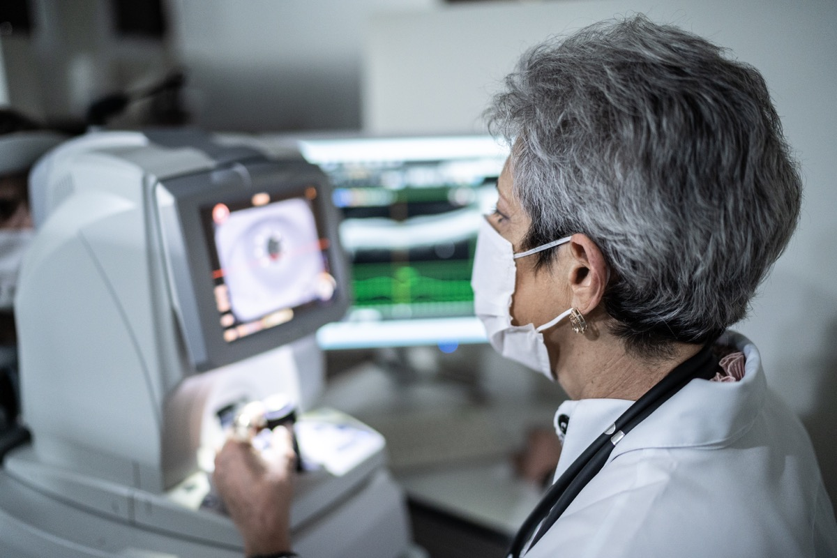 Ophthalmologist analyzing exam's results in a monitor