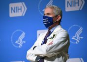 White House Chief Medical Adviser on Covid-19 Dr. Anthony Fauci listens to US President Joe Biden (out of frame) speak during a visit to the National Institutes of Health (NIH) in Bethesda, Maryland, February 11, 2021.