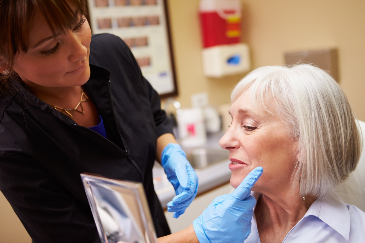 Older woman seeing plastic surgeon