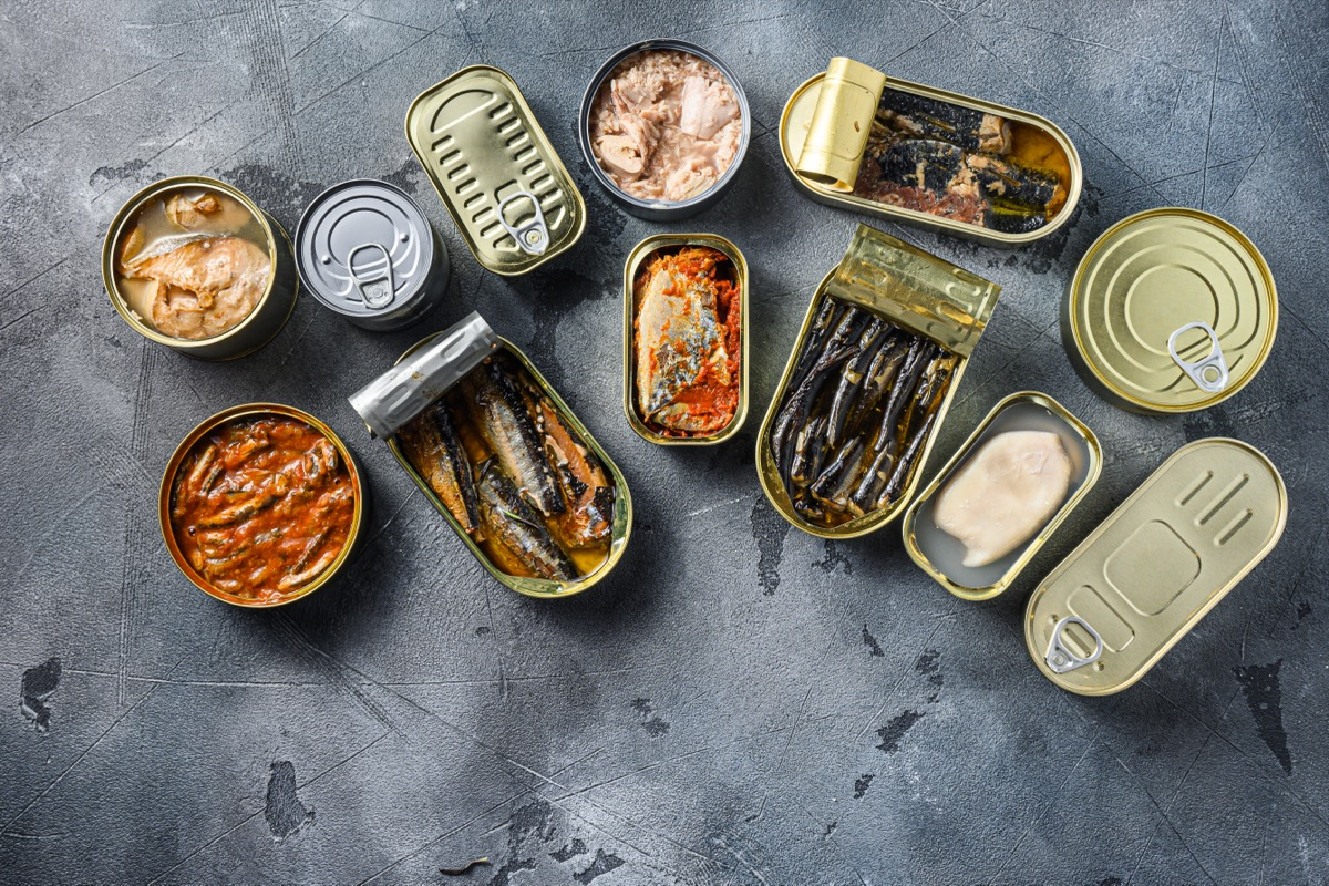 various kinds of fish in metal cans