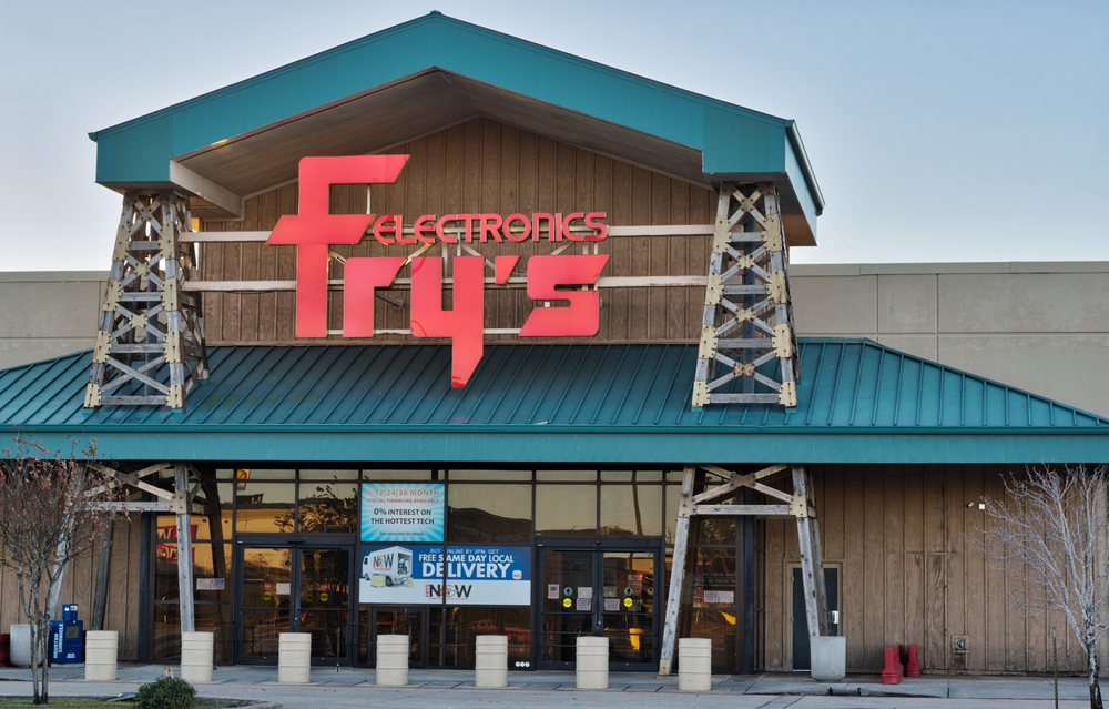 The entrance of a Fry's Electronics store with green awnings and red lettering