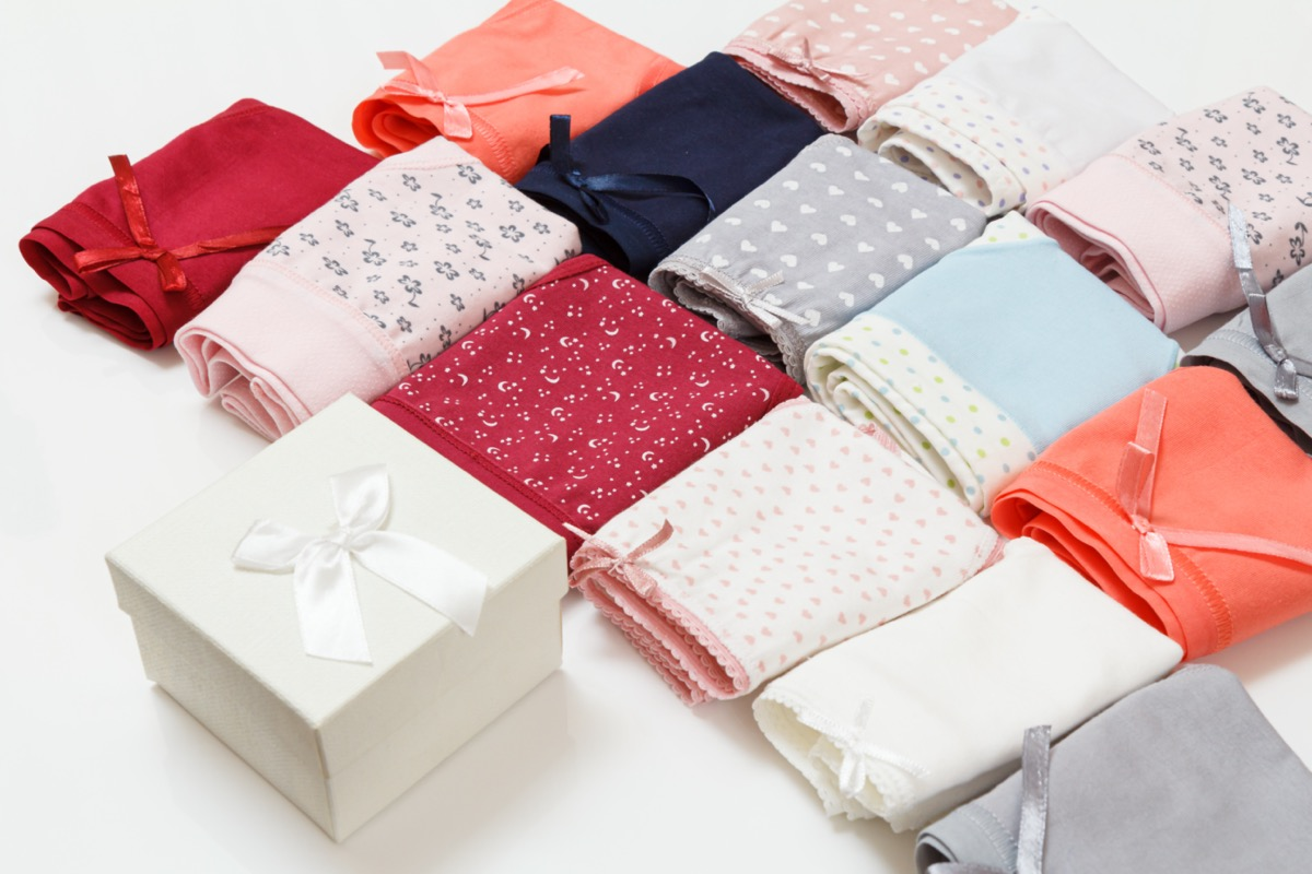 sets of folded women's underwear next to a gift box