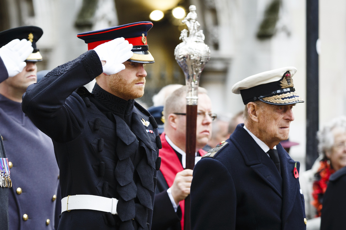 Prince Harry and Prince Philip, Duke of Edinbrugh attend the Fields of Remembrance at Westminster Abbey on November 10, 2016 in London, England.