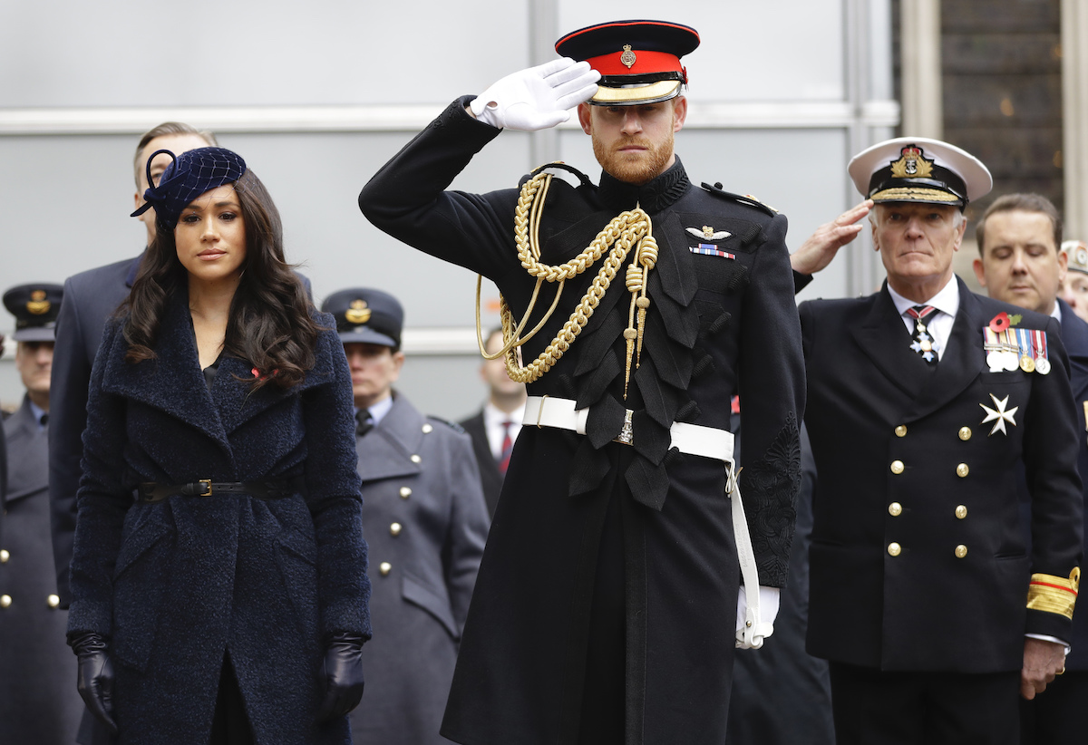 Britain's Prince Harry, Duke of Sussex and his wife Meghan, Duchess of Sussex pay their respects after laying a Cross of Remembrance in front of wooden crosses from the Graves of Unknown British Soldiers from the First and Second World Wars, during their visit to the Field of Remembrance at Westminster Abbey in central London on November 7, 2019