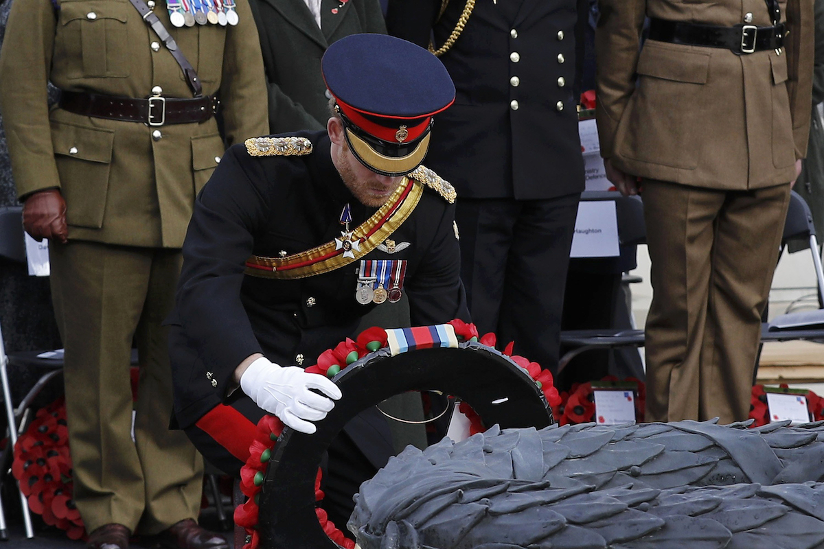 Britain's Prince Harry lays a wreath on the Armed Forces Memorial during a service of remembrance on Armistice Day at the National Memorial Arboretum, in Alrewas, central England on November 11, 2016