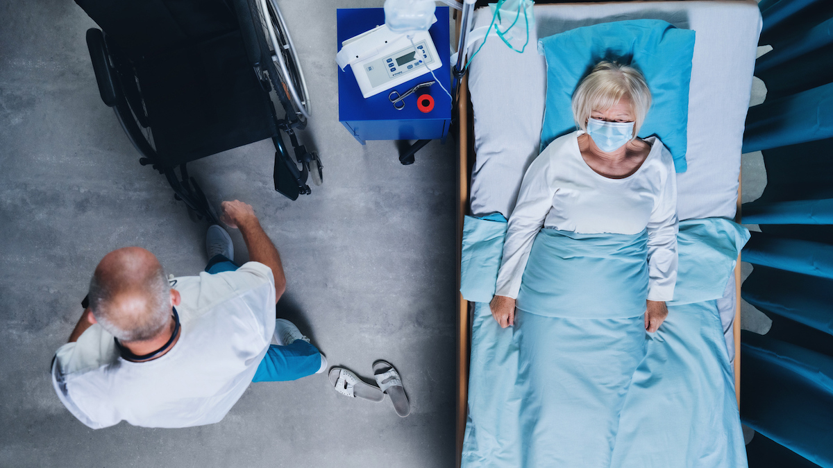Top view of doctor talking to covid-19 patient