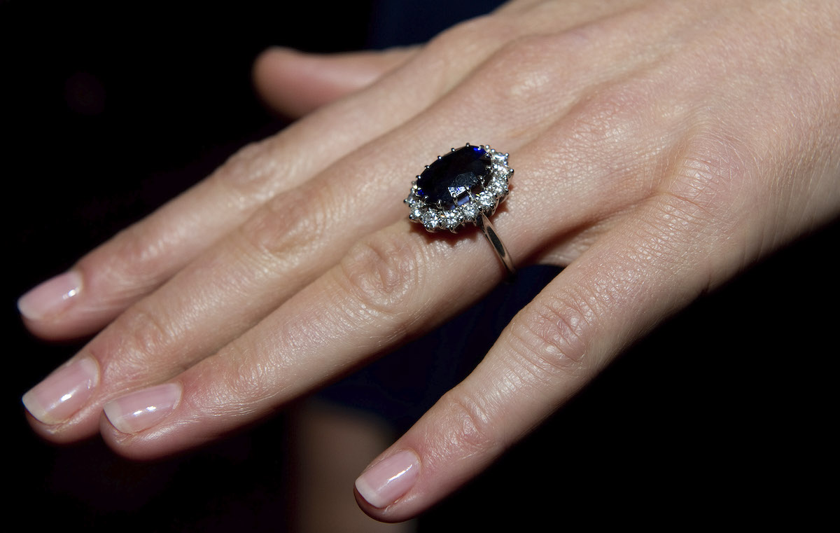 A close up of Kate Middleton's engagement ring as she poses for photographs in the State Apartments with her fiance Prince William