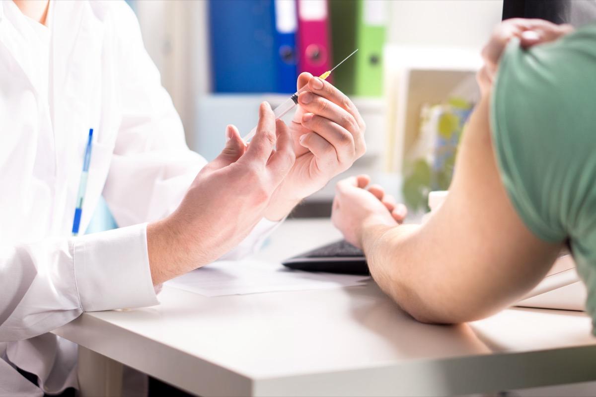 Person getting COVID vaccine
