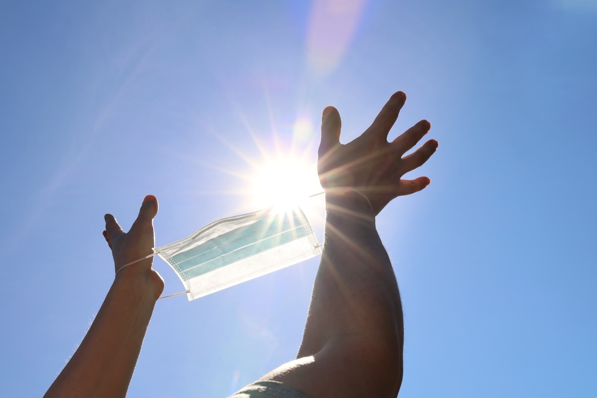 Holding mask to sunlight