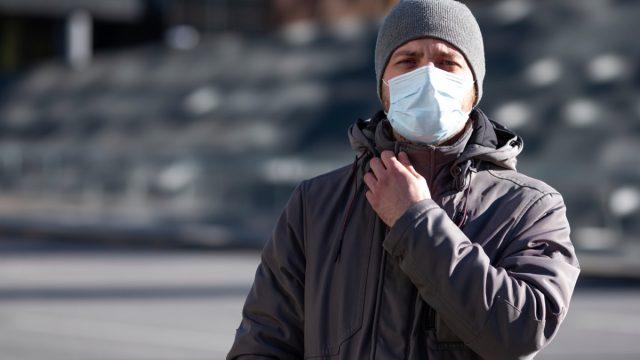 Man wearing a mask outside