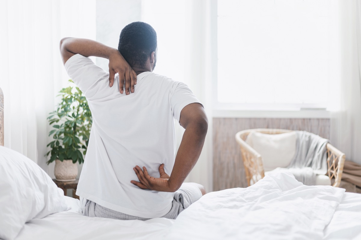 man with backache and muscle pain