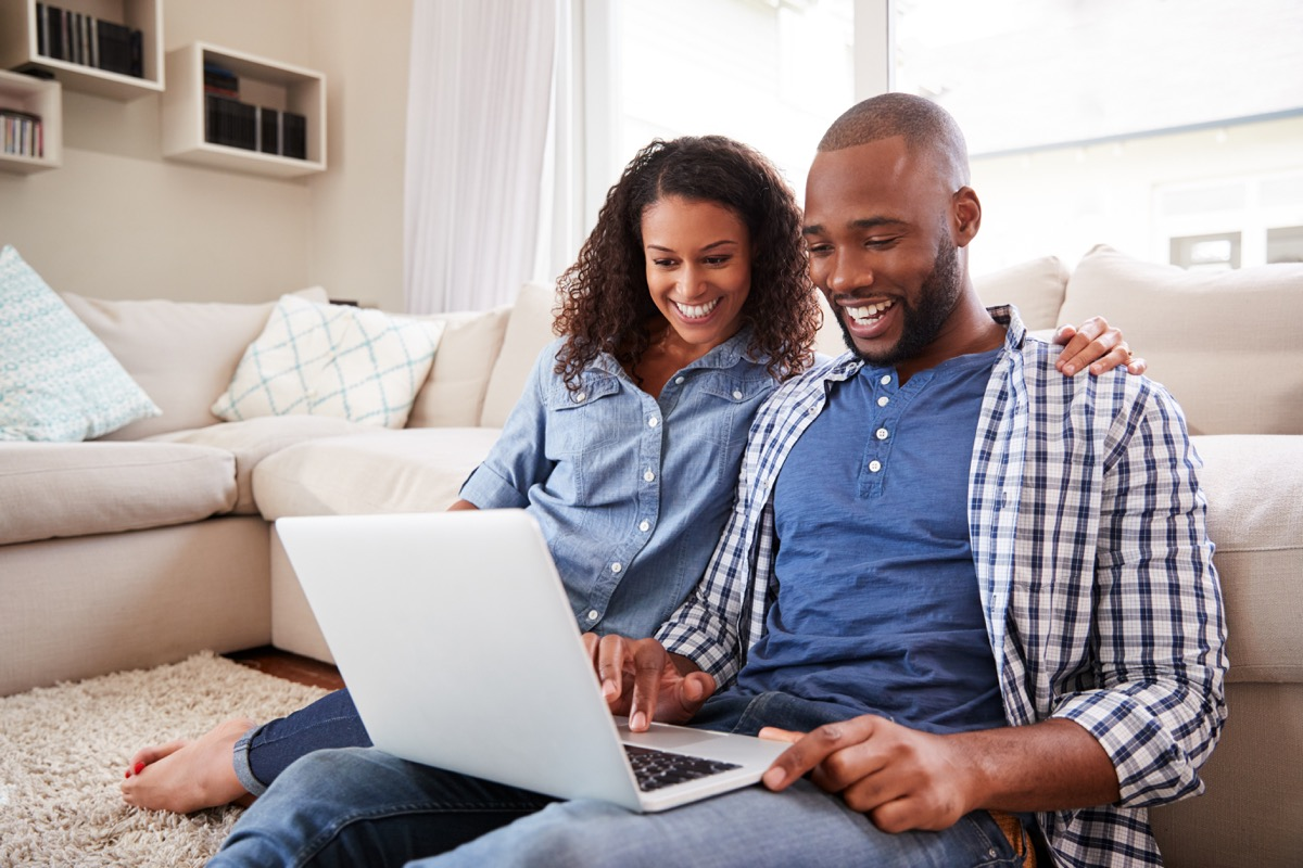 Couple looking at laptop together