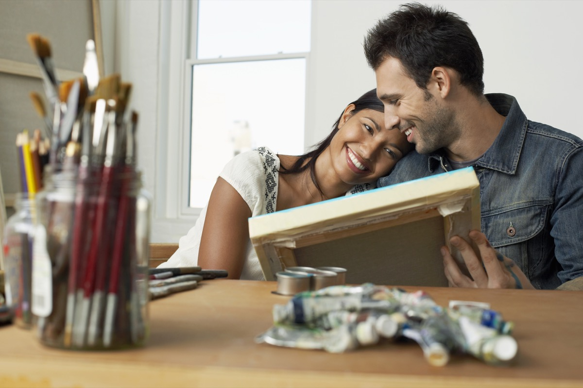 Couple painting together at home