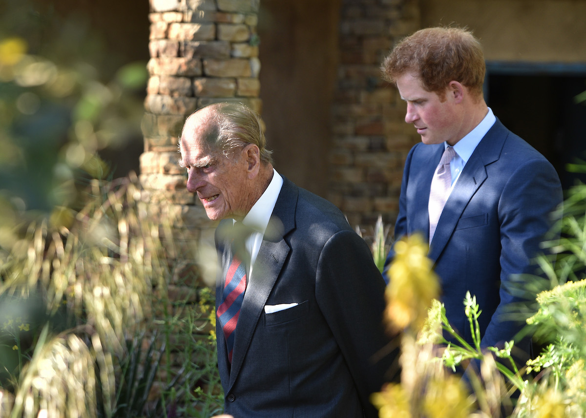 Prince Philip, Duke of Edinburgh and Price Harry attend the annual Chelsea Flower show at Royal Hospital Chelsea on May 18, 2015 in London, England