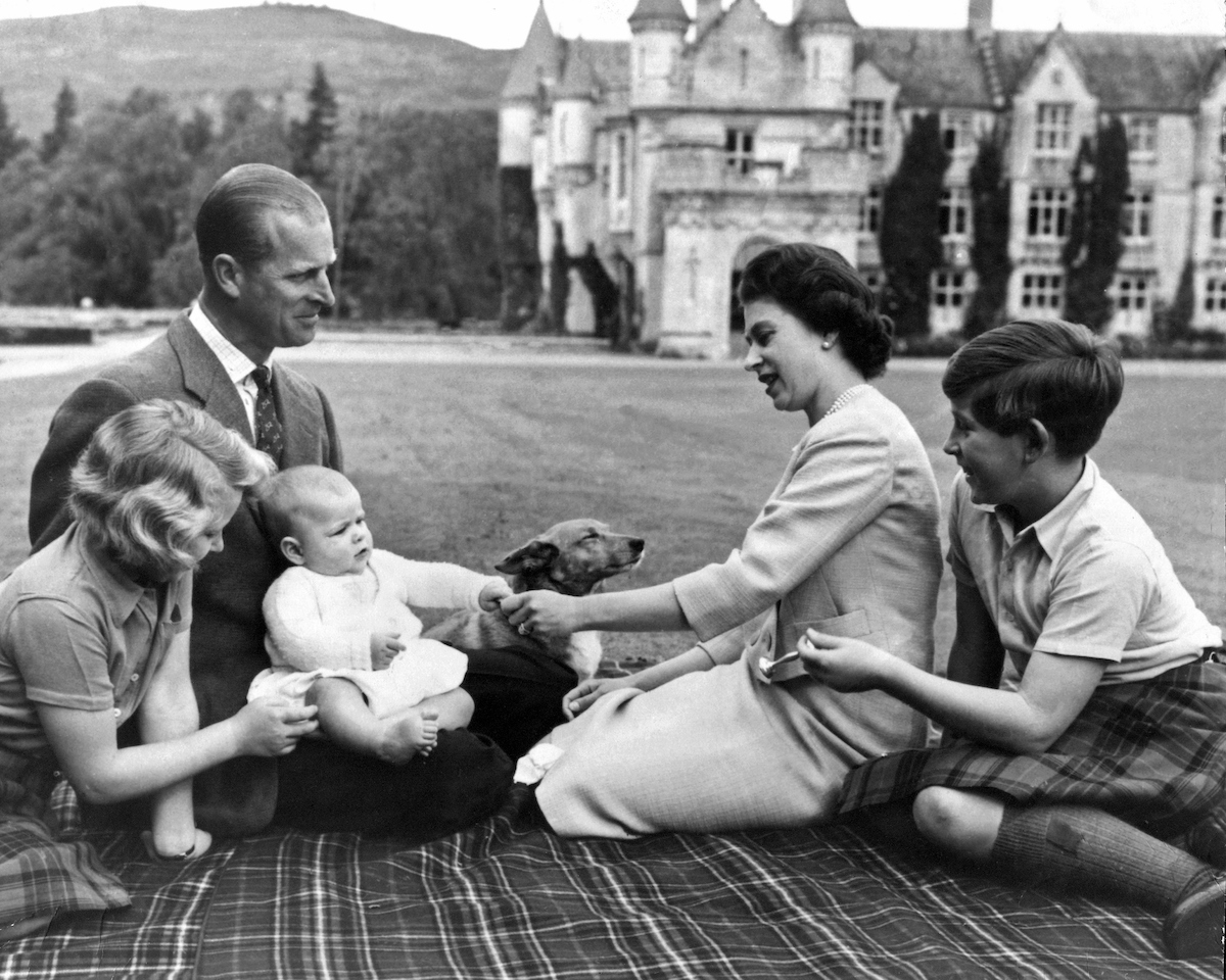 Queen Elizabeth II and her husband Prince Philip, Duke of Edinburgh, with their children Princess Anne, Prince Charles (right) and Prince Andrew on his first holiday to Balmoral