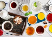 Different cold and hot drinks on wooden table. Tea, milk, juice, coffee, smoothie, water, etc.