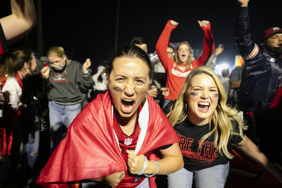 Tampa Bay Buccaneers' fans celebrate their victory outside Raymond James Stadium after winning the Super Bowl LV, in Tampa, Florida, United States on February 07, 2021.