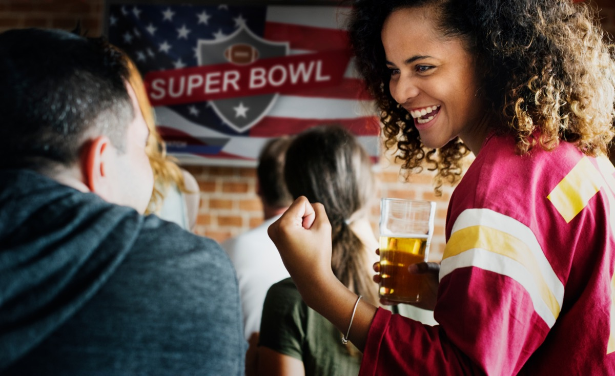 two friends at a super bowl party