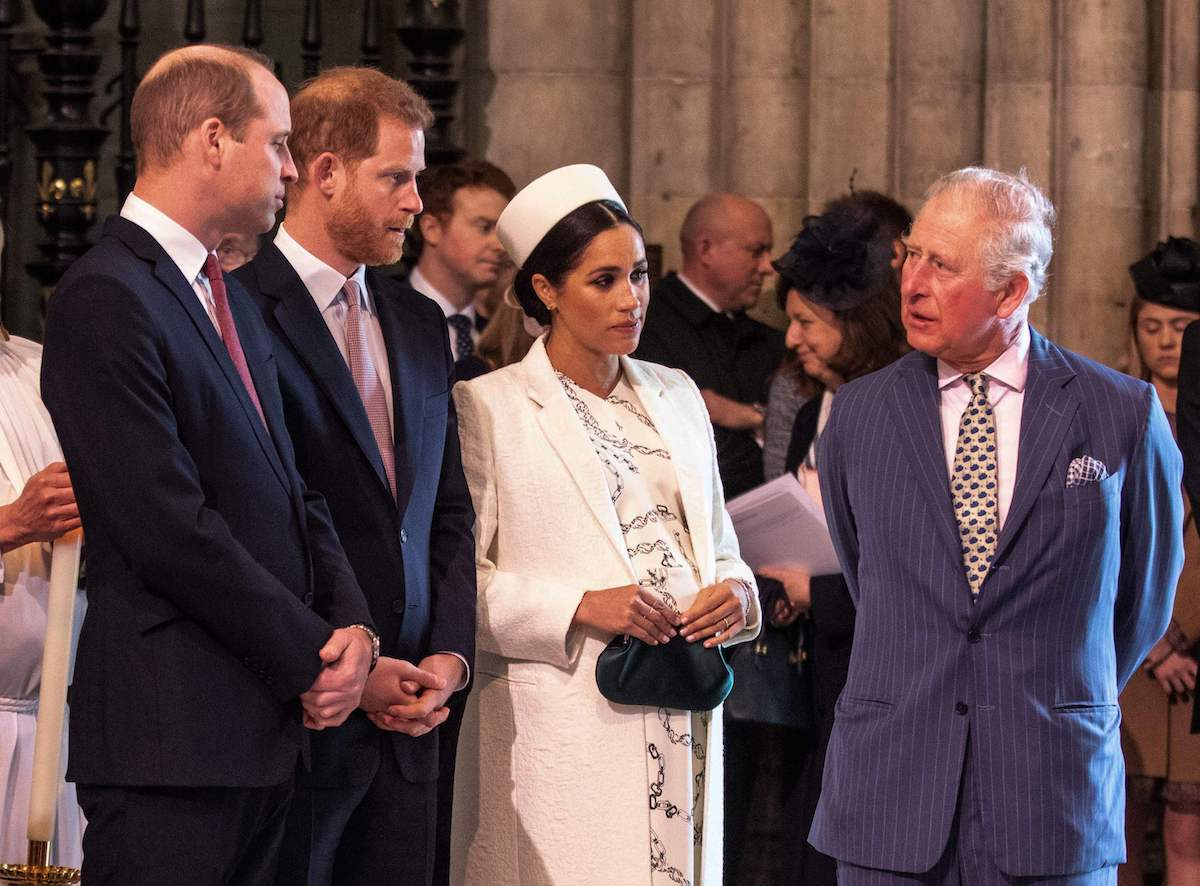 Meghan, Duchess of Sussex talks with Prince Charles, Prince of Wales, as Prince William, Duke of Cambridge, talks with Prince Harry, Duke of Sussex, as they all attend the Commonwealth Day service at Westminster Abbey in London on March 11, 2019.