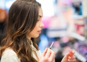 young woman trying makeup in a store
