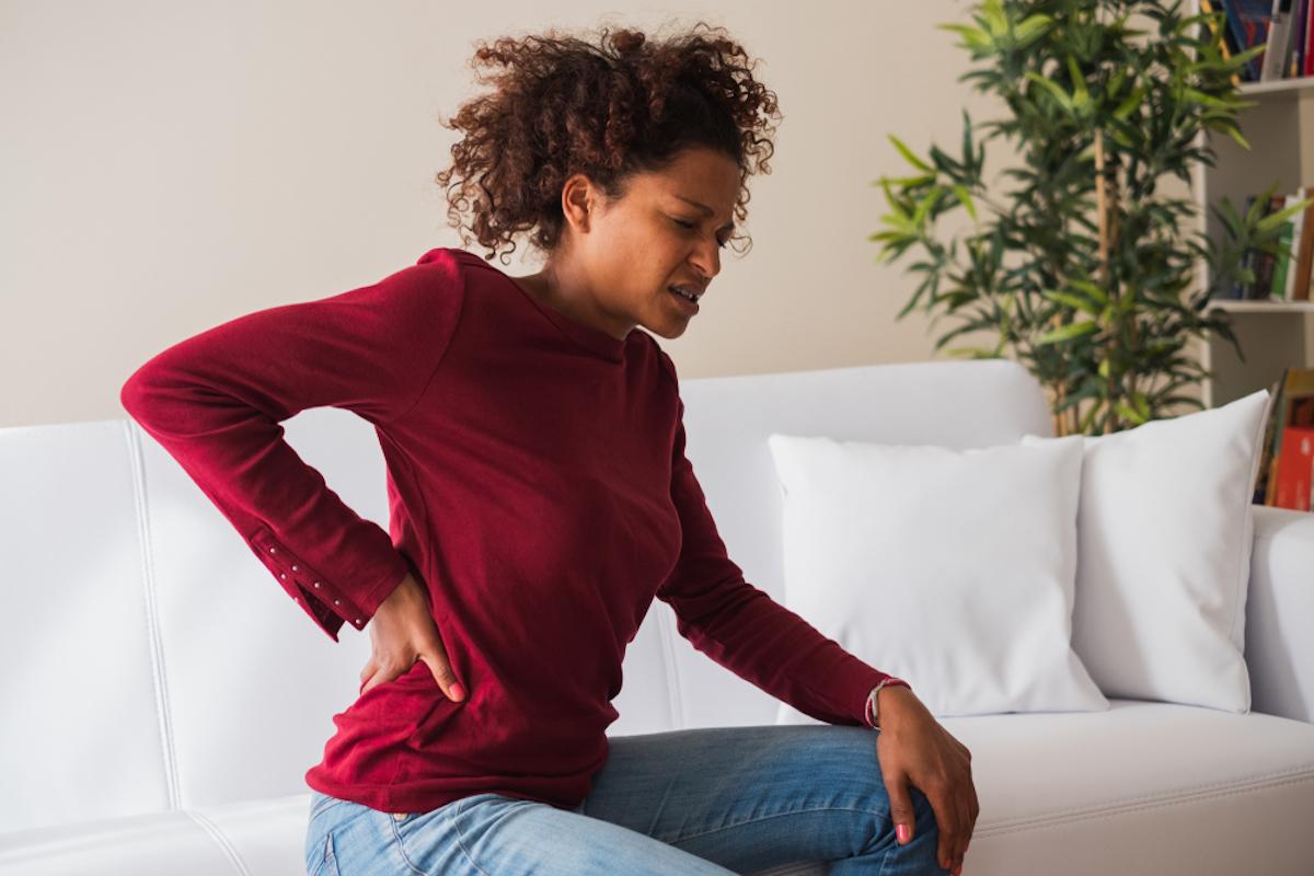 Woman suffering back pain