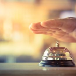 Hand over bell at hotel reception