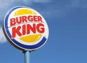 Burger King sign against blue sky