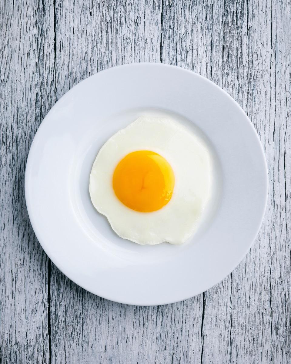 Fried egg on white plate