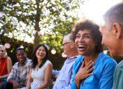 Mature friends laughingat backyard party