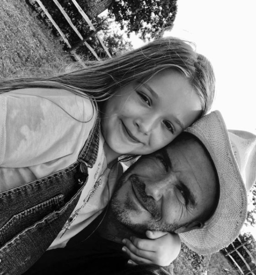 A black and white photo of Harper and David Beckham