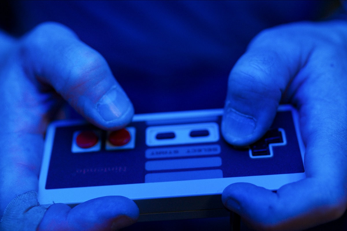 Close up on Nintendo controller from High Score