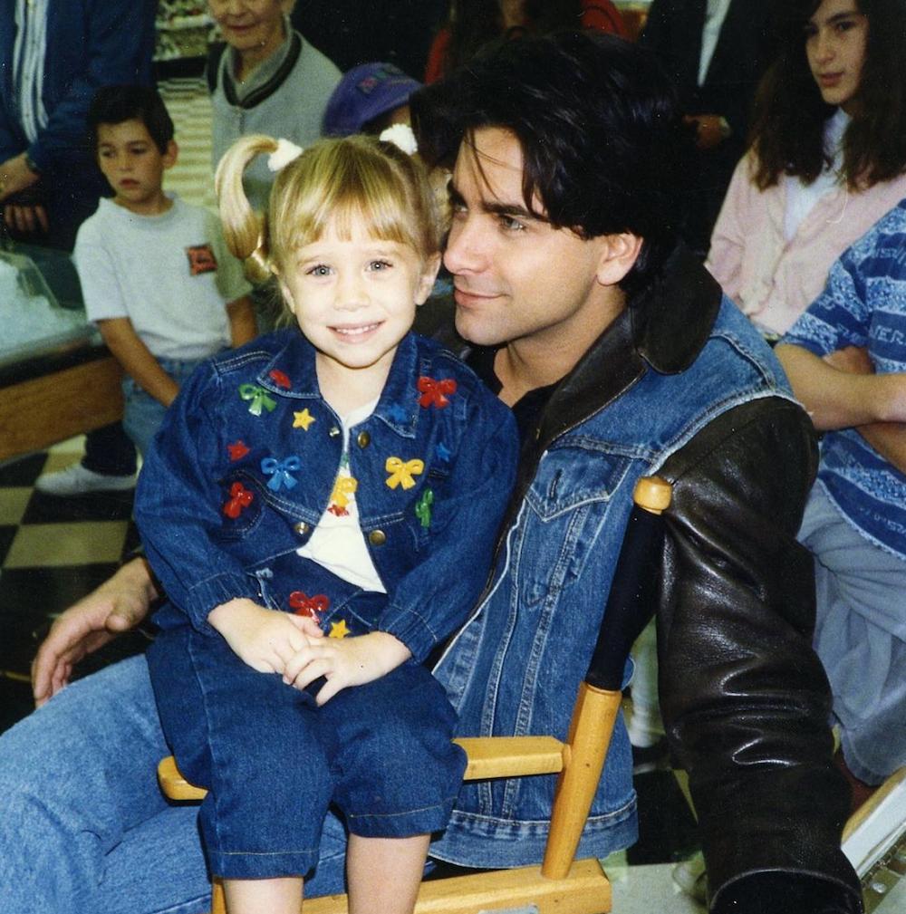 John Stamos with an Olsen twin.