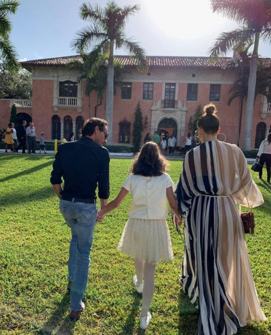 Marc Anthony, Emme, and Jennifer Lopez walking hand-in-hand