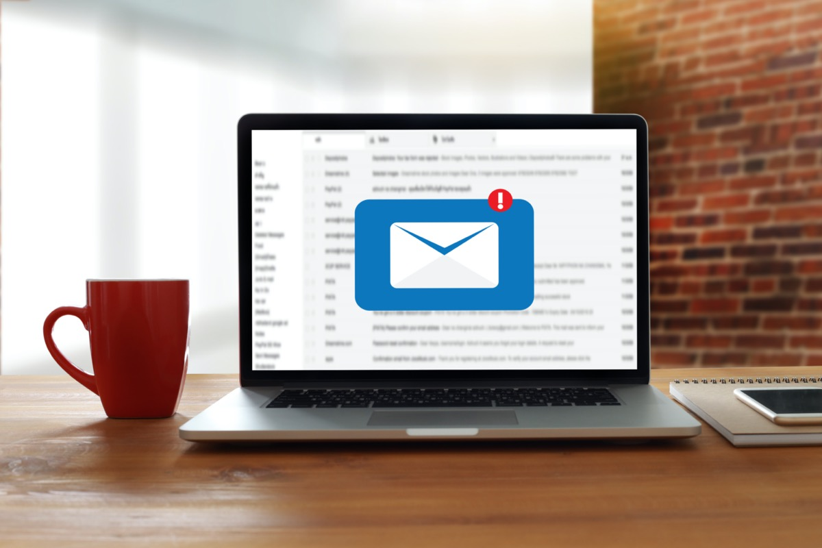 Laptop on table with new email notification