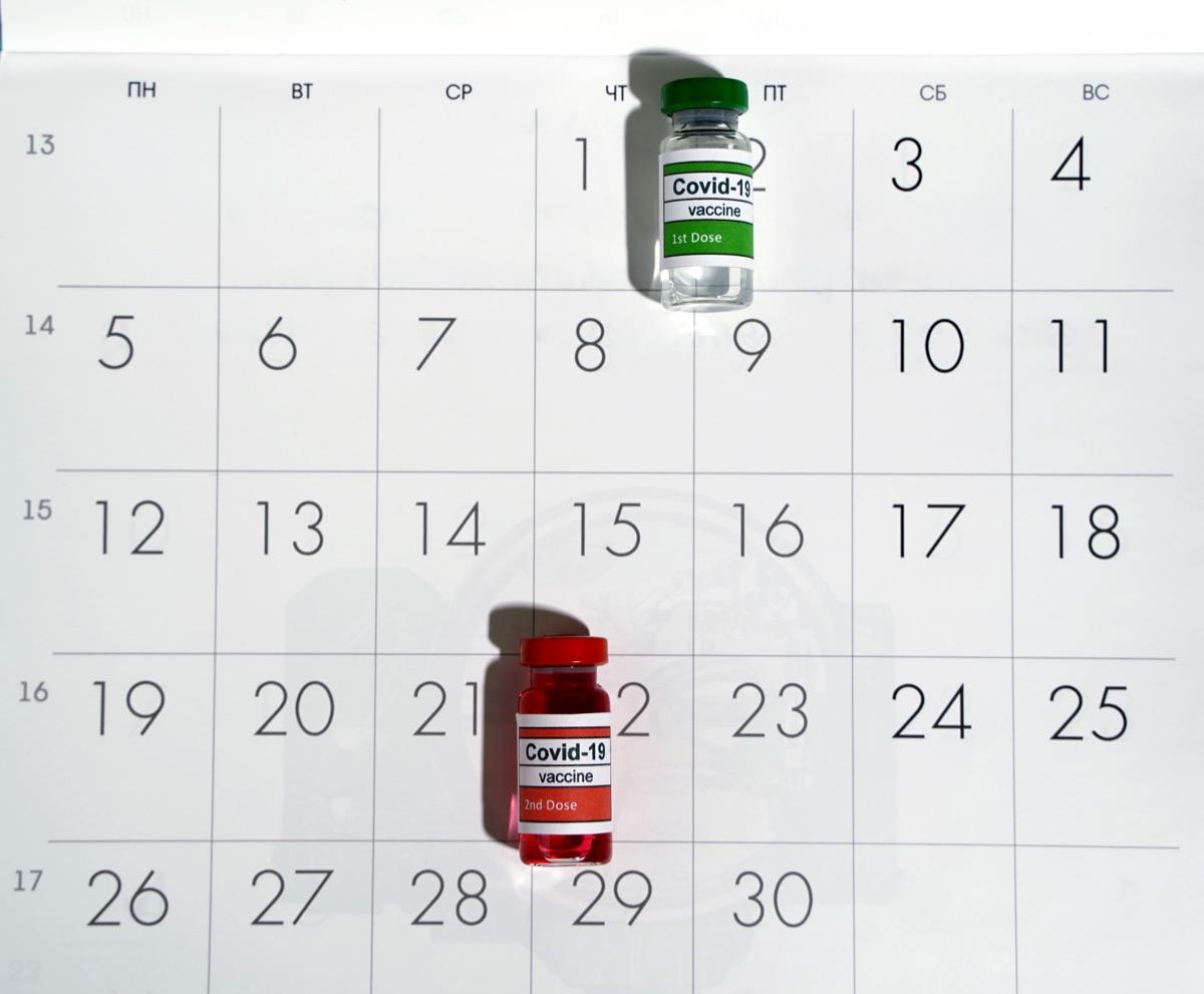 Vials of COVID vaccine on calendar