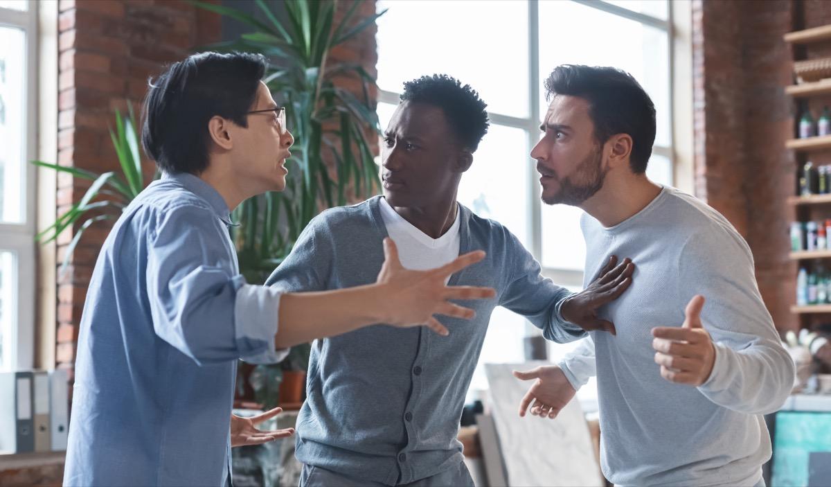 coworkers having quarrel in office, conflict of interest