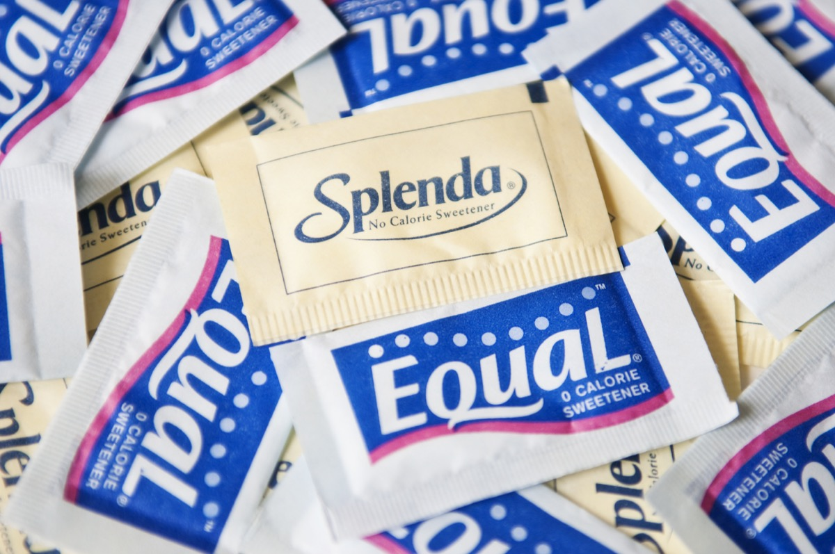 New York, USA - May 20, 2011: Splenda and Equal Product Shot zero calorie sweeteners: Splenda in a yellow packet, Equal in a blue packet. Splenda and Equal are artificial sweeteners used as a sugar substitute.