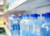 drinking bottled water in store