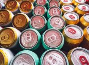 Metal cans with ice cubes in mini refrigerator
