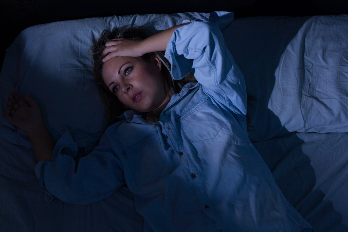Young woman awake at night