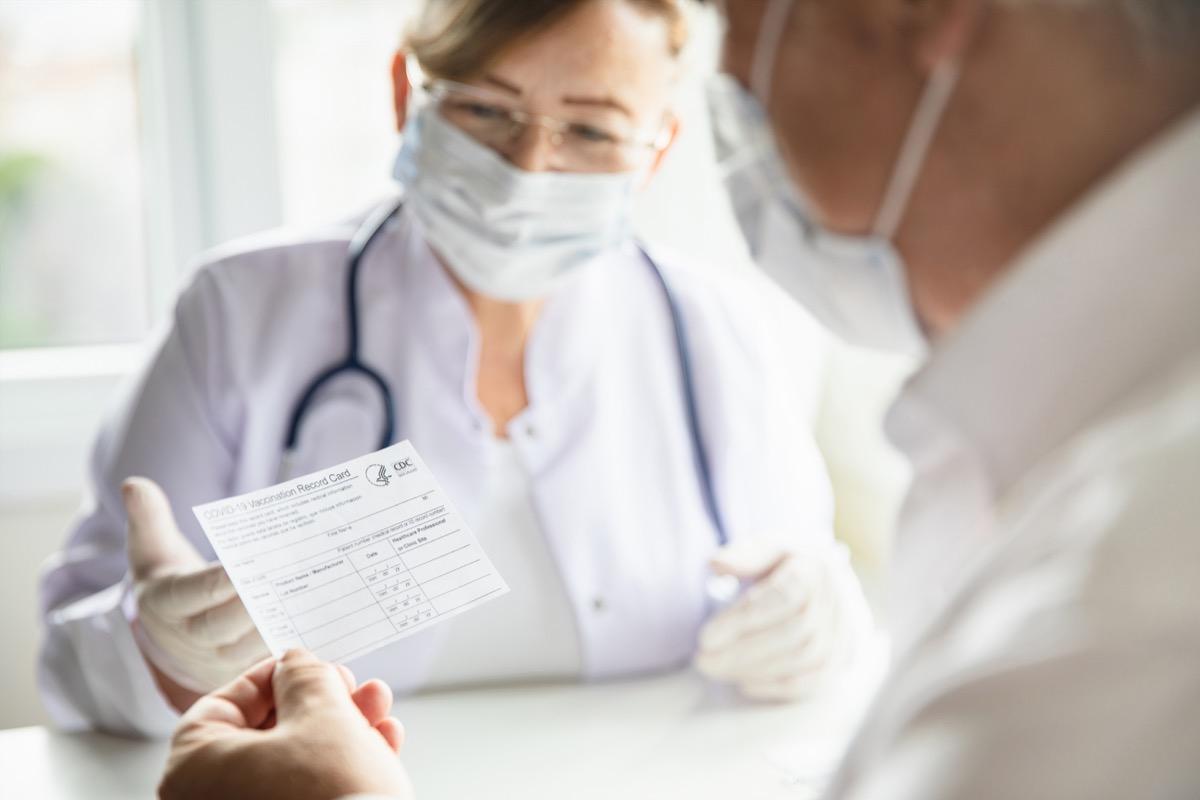 Man holding a vaccine card