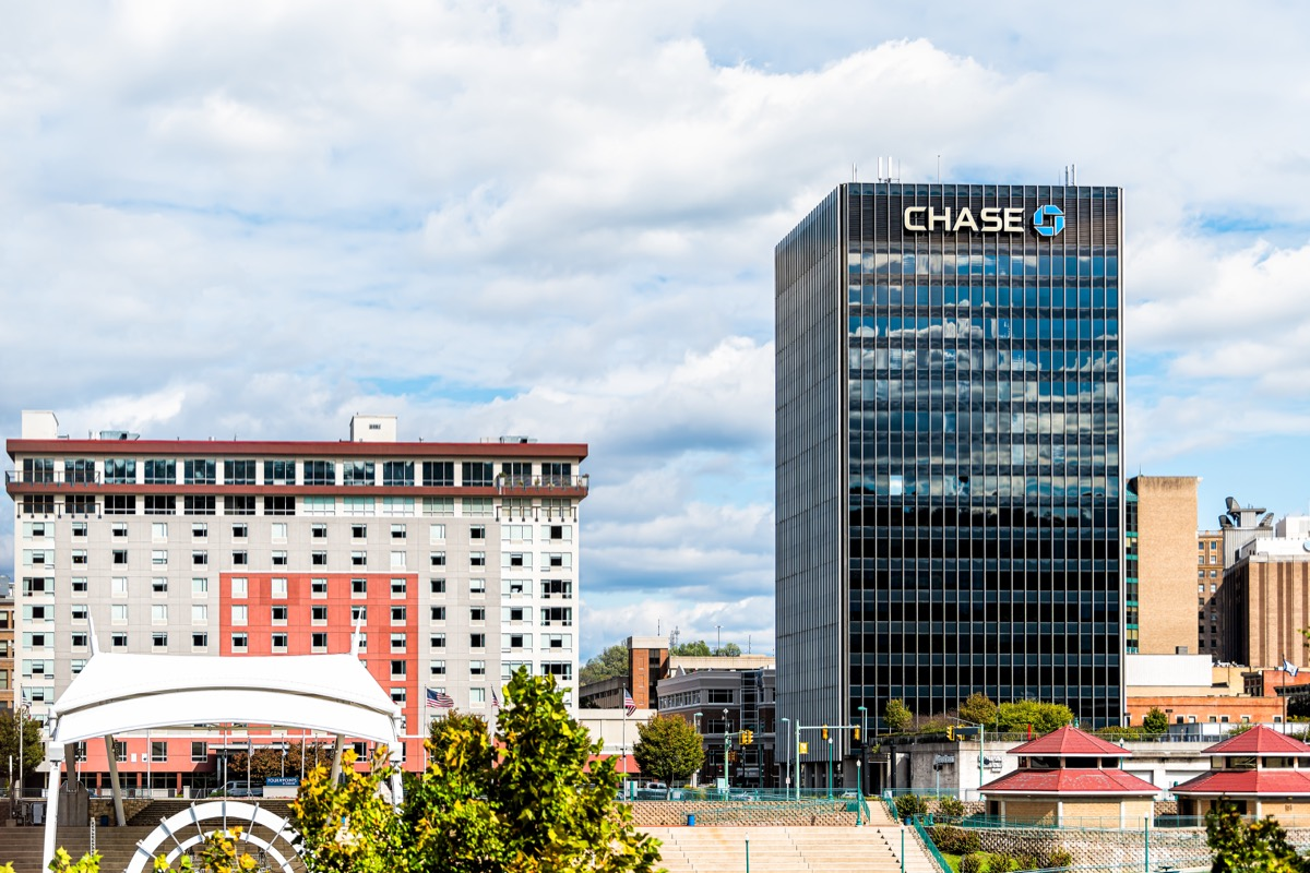 Charleston, USA - October 17, 2019: West Virginia capital city cityscape skyline with Chase bank and logo on building and cloudy sky