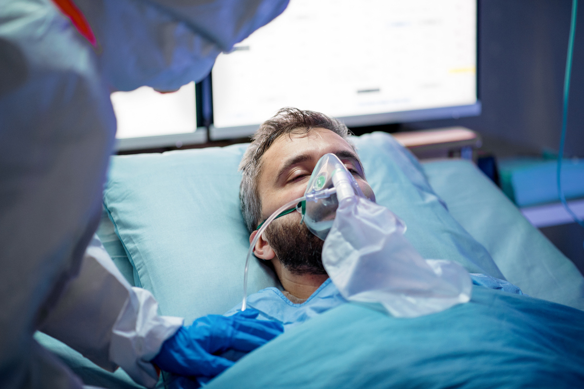 An infected patient in laying in bed in hospital